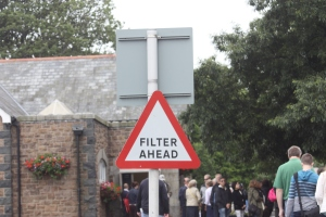 "Rather than merge,which sounds rather chaotic, this sign in Guernsey instructs drivers to  ""filter"", a much more civilized-sounding process."